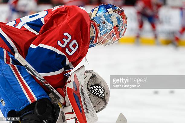 Goaltender Mike Condon of the Montreal Canadiens prepares during the warmup prior to the NHL game against the Calgary Flames at the Bell Centre on...