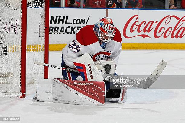 Goaltender Mike Condon of the Montreal Canadiens stops a shot by the Florida Panthers during first period action at the BBT Center on April 2 2016 in...