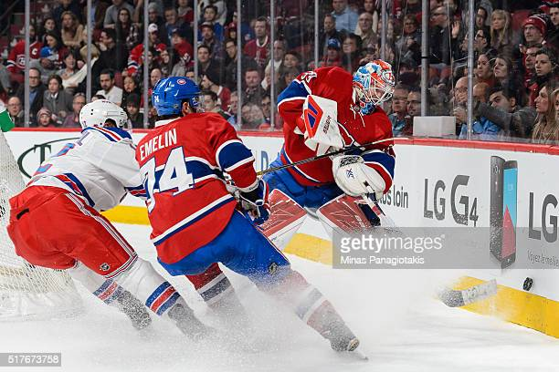 Goaltender Mike Condon of the Montreal Canadiens tries to clear the puck against the boards during the NHL game against the New York Rangers at the...