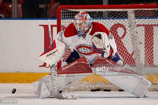 Goaltender Mike Condon of the Montreal Canadiens warms up on the ice prior to the start of the game against the Florida Panthers at the BBT Center on...