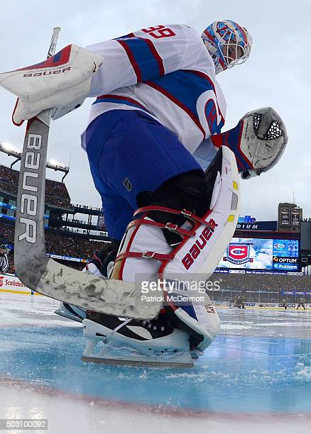 Goaltender Mike Condon of the Montreal Canadiens works the ice in his crease prior to the start of the 2016 Bridgestone NHL Classic against the...