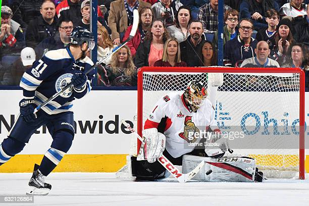 Goaltender Mike Condon of the Ottawa Senators blocks a shot taken by Nick Foligno of the Columbus Blue Jackets during the second period of a game on...