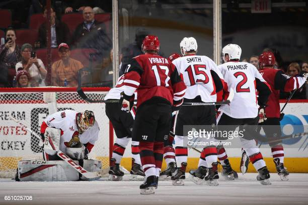 Goaltender Mike Condon of the Ottawa Senators makes a save on the shot during the third period of the NHL game against the Arizona Coyotes at Gila...