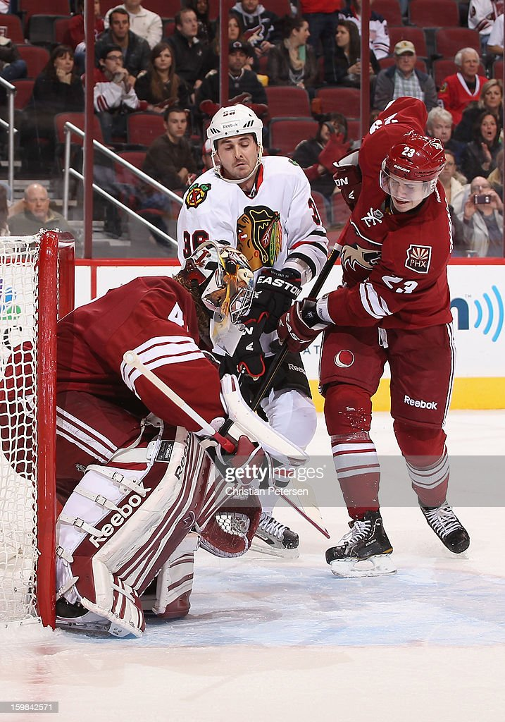 Goaltender Mike Smith #41 and Oliver Ekman-Larsson #23 of the Phoenix Coyotes cover the puck as Dave Bolland #36 of the Chicago Blackhawks skates in during the NHL game at Jobing.com Arena on January 20, 2013 in Glendale, Arizona. The Blackhawks defeated the Coyotes 6-4.
