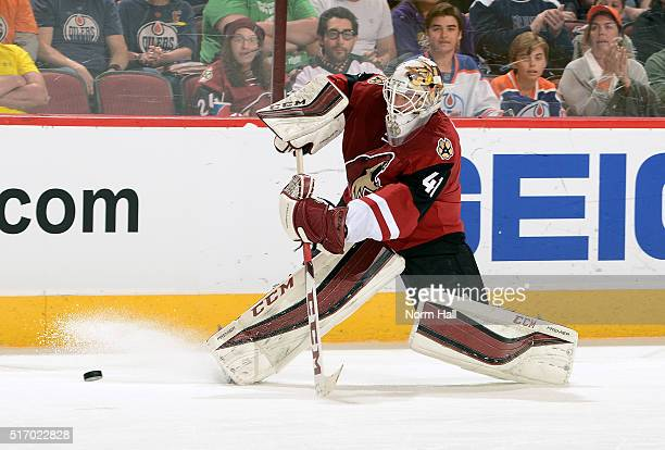 Goaltender Mike Smith of the Arizona Coyotes comes out of the net to play the puck during the first period against the Edmonton Oilers at Gila River...