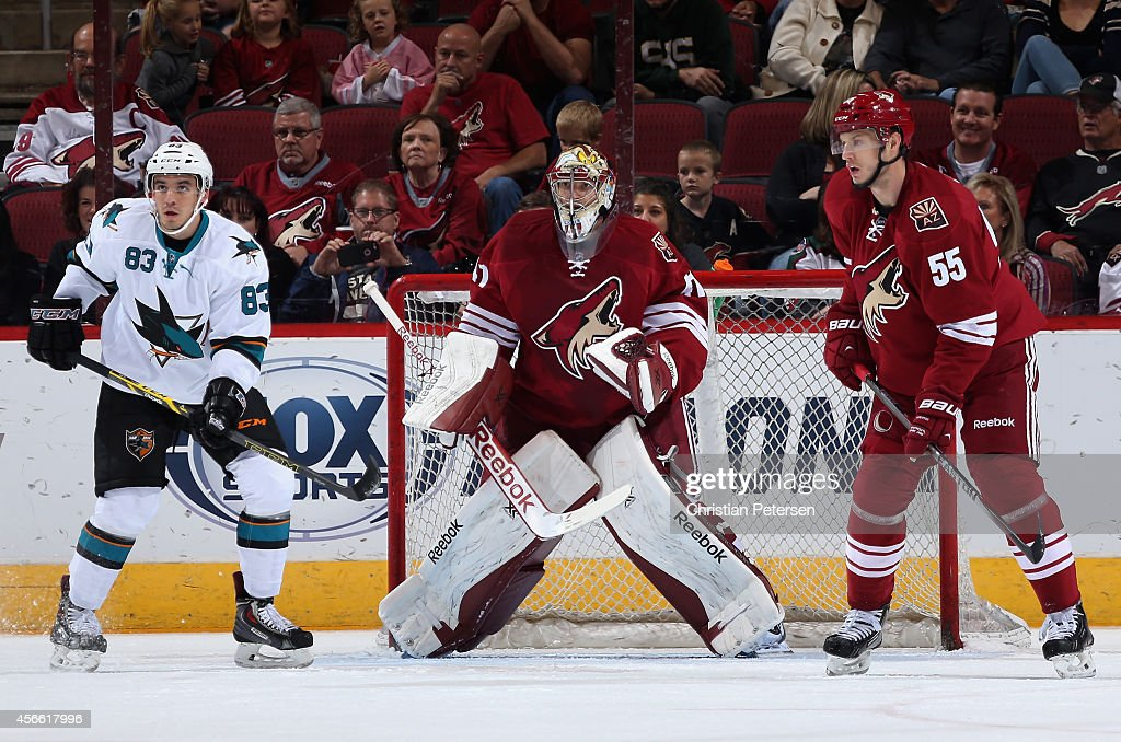Goaltender Mike Smith #41 of the Arizona Coyotes looks around Matt Nieto #83 of the San Jose Sharks during the preseason NHL game at Gila River Arena on October 3, 2014 in Glendale, Arizona. The Sharks defeated the Coyotes 3-1.
