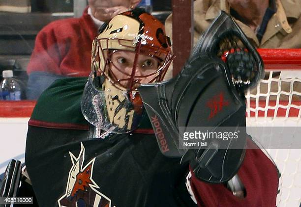 Goaltender Mike Smith of the Arizona Coyotes makes a glove save against the Vancouver Canucks during the third period at Gila River Arena on March 5...