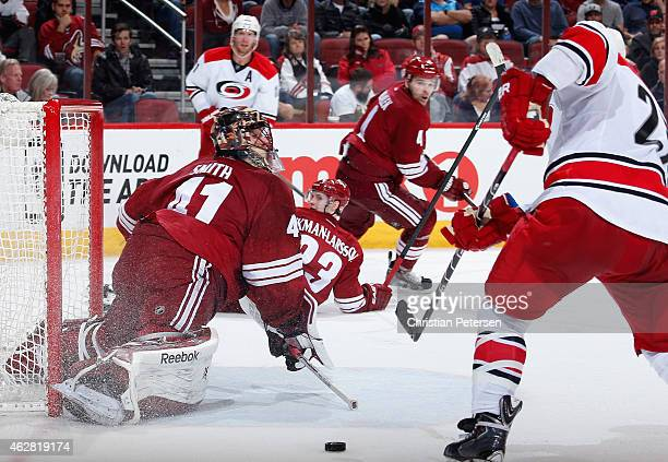 Goaltender Mike Smith of the Arizona Coyotes makes a pad save on a shot from Justin Faulk of the Carolina Hurricanes during overtime of the NHL game...