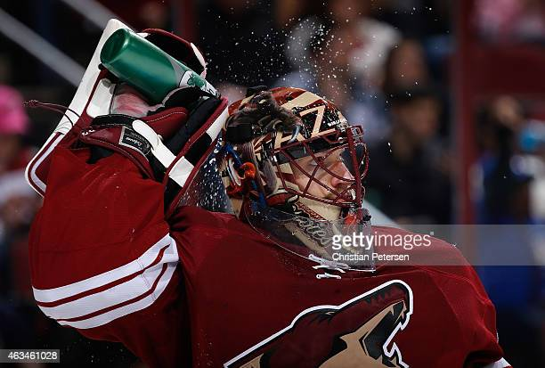 Goaltender Mike Smith of the Arizona Coyotes sprays himself with water after allowing a second period goal to the New York Rangers during the NHL...
