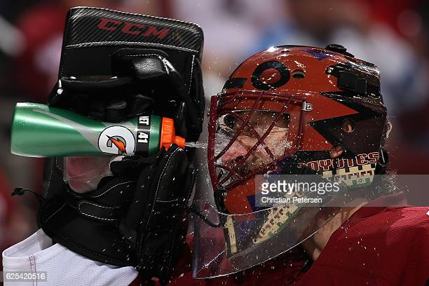 Goaltender Mike Smith of the Arizona Coyotes sprays water in his face after giving up a goal to the Vancouver Canucks during the second period of the...