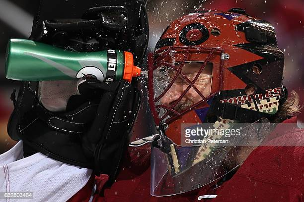 Goaltender Mike Smith of the Arizona Coyotes sprays water in his face during a break from the second period of the NHL game against the Vancouver...