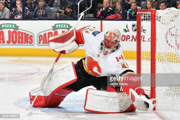 Goaltender Mike Smith of the Calgary Flames defends the net against the Columbus Blue Jackets on November 22 2017 at Nationwide Arena in Columbus Ohio