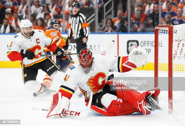 Goaltender Mike Smith of the Calgary Flames makes a save against the Edmonton Oilers at Rogers Place on October 4 2017 in Edmonton Canada