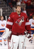 Goaltender Mike Smith of the Phoenix Coyotes before the NHL game against the New York Islanders at Jobingcom Arena on December 12 2013 in Glendale...