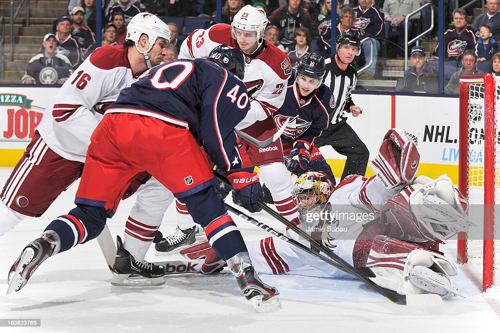 Goaltender Mike Smith #41 of the Phoenix Coyotes blocks a shot taken by the Columbus Blue Jackets during the first period on March 16, 2013 at Nationwide Arena in Columbus, Ohio.