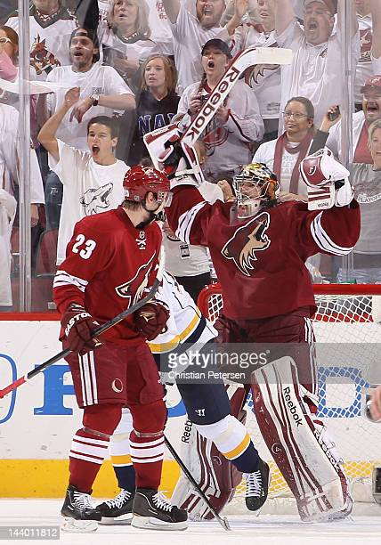 Goaltender Mike Smith of the Phoenix Coyotes celebrates with Oliver EkmanLarsson after defeating the Nashville Predators in Game Five of the Western...