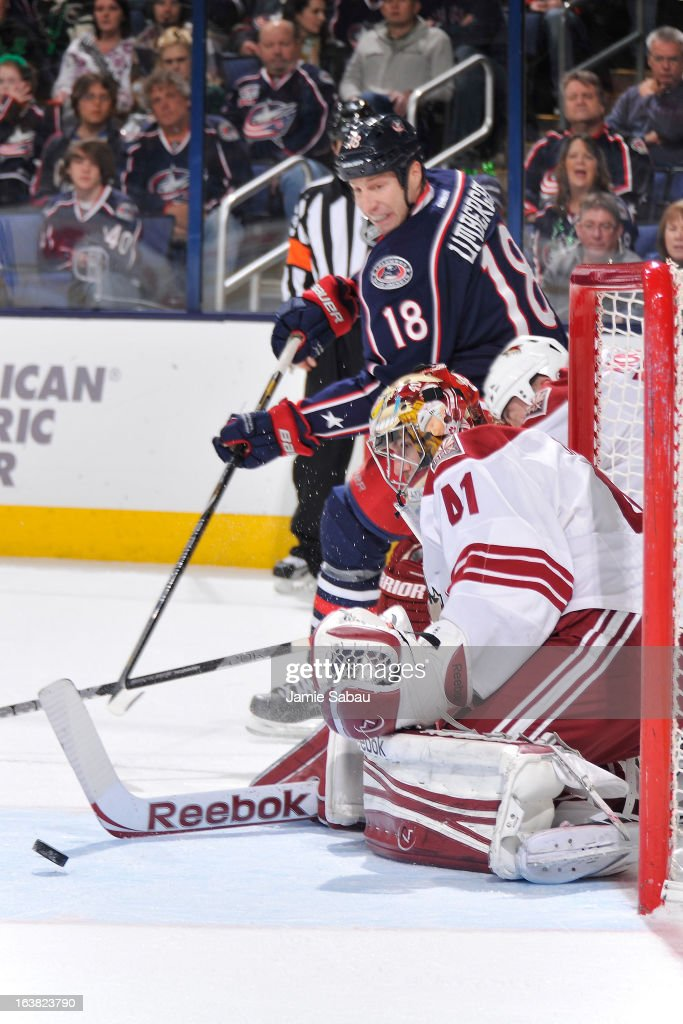 Goaltender Mike Smith #41 of the Phoenix Coyotes follows the puck after an attempted wrap around shot by R.J. Umberger #18 of the Columbus Blue Jackets during the first period on March 16, 2013 at Nationwide Arena in Columbus, Ohio.