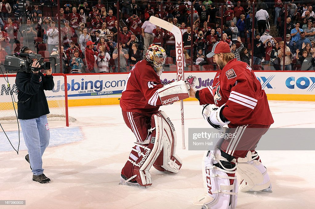 Goaltender Mike Smith #41 of the Phoenix Coyotes is congratulated by teammate <a gi-track='captionPersonalityLinkClicked' href=/galleries/search?phrase=Jason+LaBarbera&family=editorial&specificpeople=240674 ng-click='$event.stopPropagation()'>Jason LaBarbera</a> #1 after a 2-1 victory over the San Jose Sharks at Jobing.com Arena on April 24, 2013 in Glendale, Arizona.