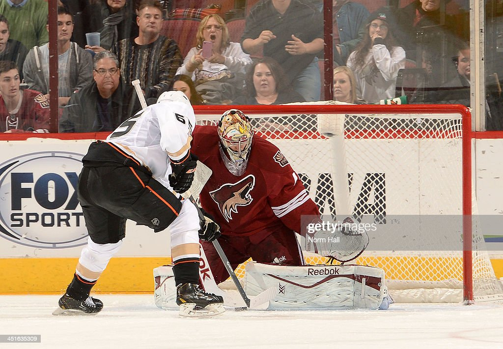 Goaltender Mike Smith #41 of the Phoenix Coyotes makes a stick save on a shot by <a gi-track='captionPersonalityLinkClicked' href=/galleries/search?phrase=Emerson+Etem&family=editorial&specificpeople=6365314 ng-click='$event.stopPropagation()'>Emerson Etem</a> #65 of the Anaheim Ducks during the second period at Jobing.com Arena on November 23, 2013 in Glendale, Arizona.