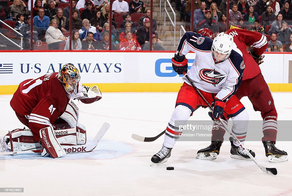 Goaltender Mike Smith #41 of the Phoenix Coyotes protects the net as Matt Calvert #11 of the Columbus Blue Jackets attempts a shot during the third period of the NHL game at Jobing.com Arena on February 16, 2013 in Glendale, Arizona. The Coyotes defeated the Blue Jackets 5-3.
