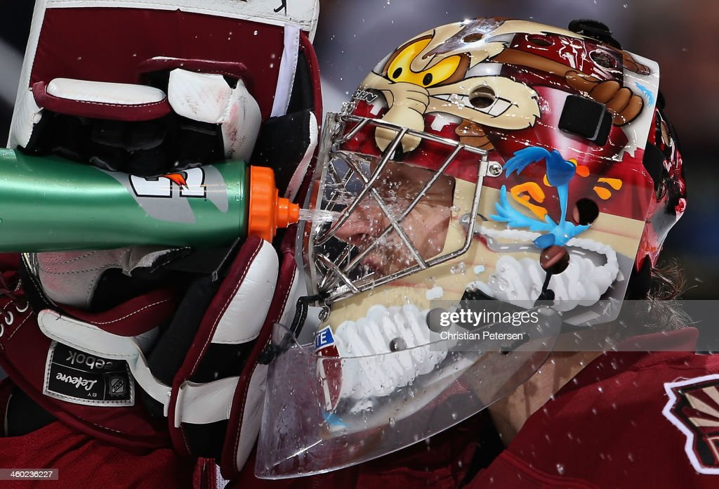 Goaltender Mike Smith #41 of the Phoenix Coyotes sprays water in his face during a break from the NHL game against the Columbus Blue Jackets at Jobing.com Arena on January 2, 2014 in Glendale, Arizona.