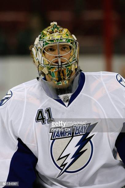 Goaltender Mike Smith of the Tampa Bay Lightning looks on during warmup prior to their NHL game against the Carolina Hurricanes at RBC Center on...