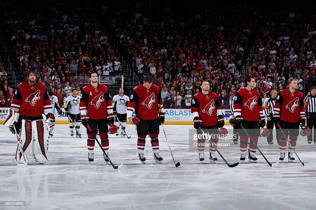 Goaltender Mike Smith #41, Oliver Ekman-Larsson #23, Michael Stone #26, Max Domi #16, Antoine Vermette #50 and Mikkel Boedker #89 of the Arizona Coyotes stand attended for the national anthem before the NHL game against the Pittsburgh Penguins at Gila River Arena on October 10, 2015 in Glendale, Arizona. The Coyotes defeated the Penguins 2-1.