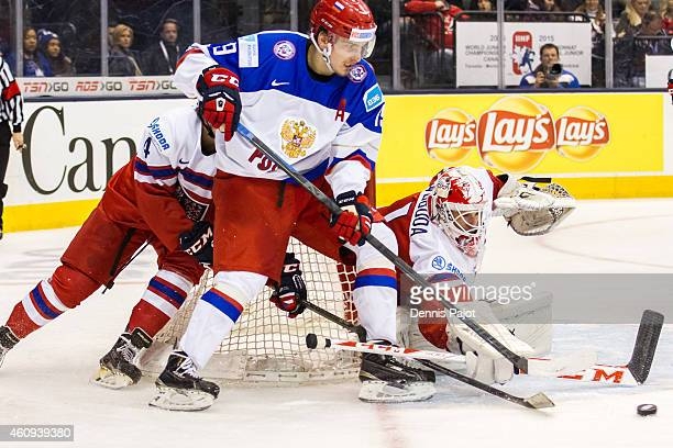 Goaltender Miroslav Svoboda of Czech Republic makes a phenomenal save against forward Pavel Buchnevich of Russia during the 2015 IIHF World Junior...