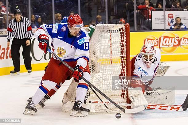 Goaltender Miroslav Svoboda of Czech Republic makes a stick save against forward Pavel Buchnevich of Russia during the 2015 IIHF World Junior...