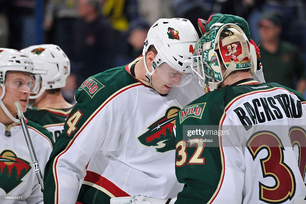 Goaltender <a gi-track='captionPersonalityLinkClicked' href=/galleries/search?phrase=Niklas+Backstrom&family=editorial&specificpeople=861018 ng-click='$event.stopPropagation()'>Niklas Backstrom</a> #32 celebrates a shutout victory with teammate <a gi-track='captionPersonalityLinkClicked' href=/galleries/search?phrase=Justin+Falk&family=editorial&specificpeople=4324950 ng-click='$event.stopPropagation()'>Justin Falk</a> #44 of the Minnesota Wild against the Columbus Blue Jackets on April 7, 2013 at Nationwide Arena in Columbus, Ohio.