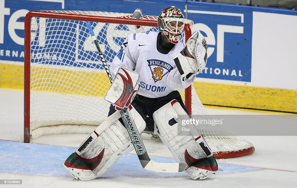 Goaltender Niklas Backstrom of Finland makes a glove save against Sweden during the Bronze Medal Game of the International Ice Hockey Federation...