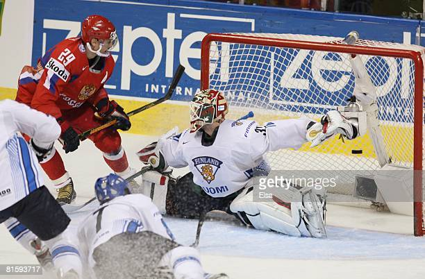 Goaltender Niklas Backstrom of Finland reaches out as Sergei Fedorov of Russia gets the puck past him during the Semifinal round of the International...