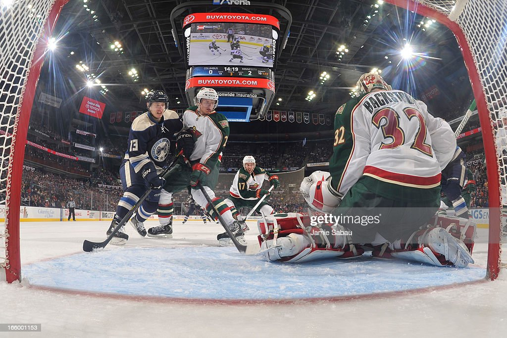 Goaltender <a gi-track='captionPersonalityLinkClicked' href=/galleries/search?phrase=Niklas+Backstrom&family=editorial&specificpeople=861018 ng-click='$event.stopPropagation()'>Niklas Backstrom</a> #32 of the Minnesota Wild makes a save during the third period against the Columbus Blue Jackets on April 7, 2013 at Nationwide Arena in Columbus, Ohio. Minnesota defeated Columbus 3-0.
