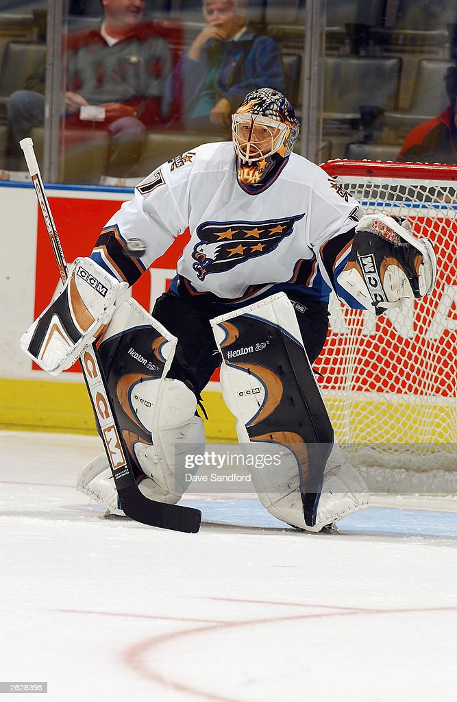 Goaltender Olaf Kolzig #37 of the Washington Capitals takes shots in warm-ups prior to the start of the NHL game against the Toronto Maple Leafs on October 13, 2003 at Air Canada Centre in Toronto, Ontario. The Maple Leafs and the Capitals skated to a 2-2 tie.