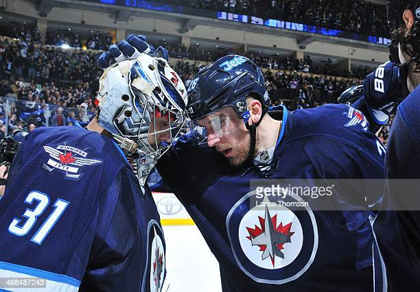 Goaltender Ondrej Pavelec and Blake Wheeler of the Winnipeg Jets celebrate following a 43 victory over the Vancouver Canucks at the MTS Centre on...