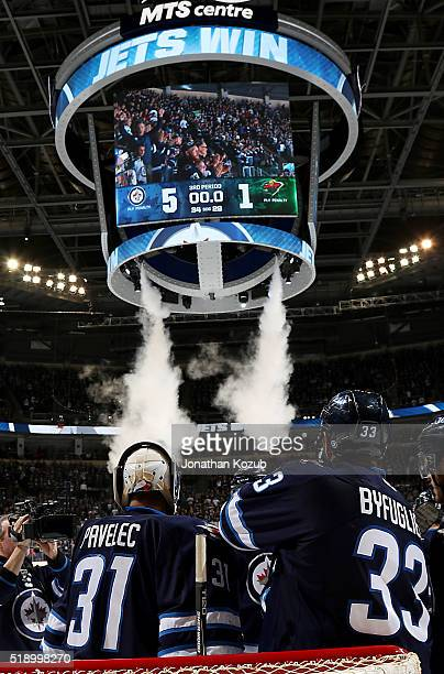 Goaltender Ondrej Pavelec and Dustin Byfuglien of the Winnipeg Jets celebrate a 51 victory over the Minnesota Wild in the final regular season home...