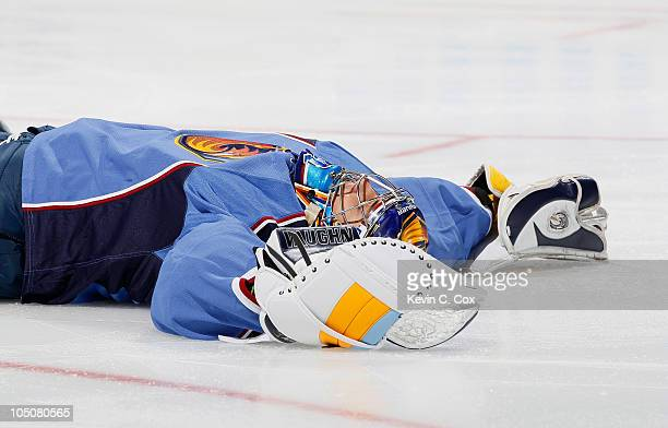 Goaltender Ondrej Pavelec of the Atlanta Thrashers lays on the ice after he fell backwards in the first few minutes of the first period against the...