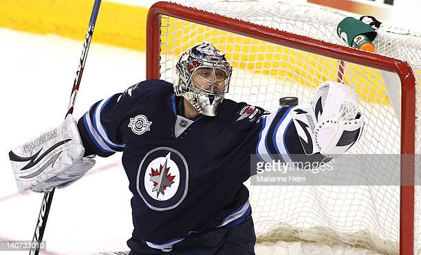 Goaltender Ondrej Pavelec of the Winnipeg Jets blocks a shot on goal by the Buffalo Sabres in NHL action at the MTS Centre on March 5 2012 in...
