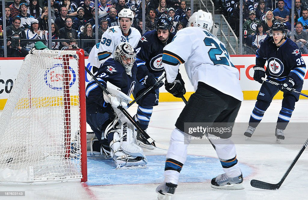 Goaltender Ondrej Pavelec #31 of the Winnipeg Jets can only watch as <a gi-track='captionPersonalityLinkClicked' href=/galleries/search?phrase=Dan+Boyle&family=editorial&specificpeople=201502 ng-click='$event.stopPropagation()'>Dan Boyle</a> #22 of the San Jose Sharks puts the puck into the open net for a third period goal at the MTS Centre on November 10, 2013 in Winnipeg, Manitoba, Canada.
