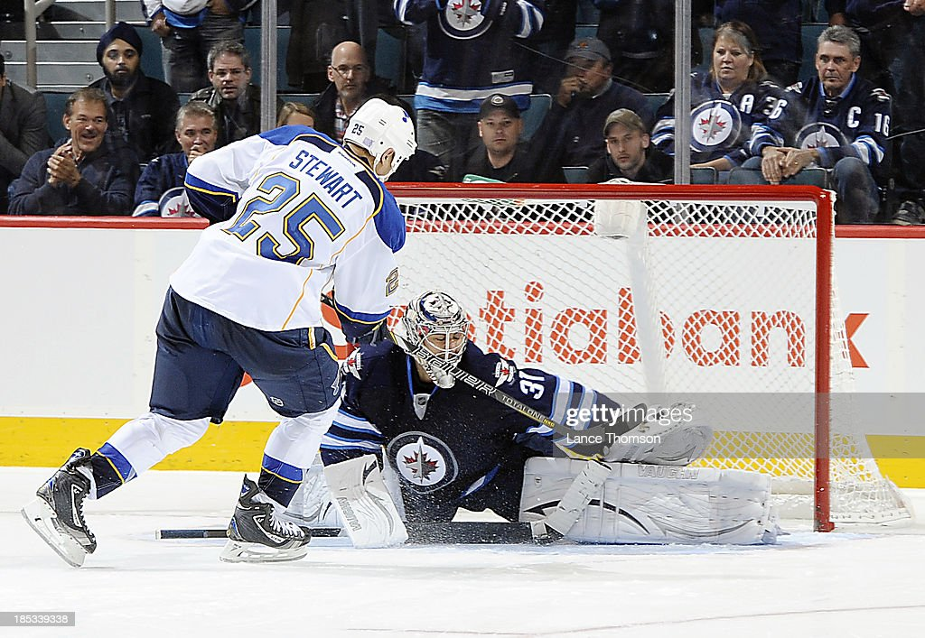 Goaltender Ondrej Pavelec #31 of the Winnipeg Jets denies Chris Stewart #25 of the St. Louis Blues in the shootout at the MTS Centre on October 18, 2013 in Winnipeg, Manitoba, Canada. The Jets won the game 4-3.