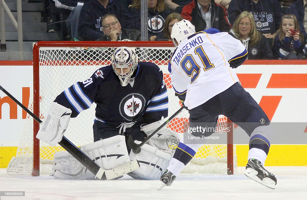 Goaltender Ondrej Pavelec #31 of the Winnipeg Jets denies <a gi-track='captionPersonalityLinkClicked' href=/galleries/search?phrase=Vladimir+Tarasenko&family=editorial&specificpeople=6142635 ng-click='$event.stopPropagation()'>Vladimir Tarasenko</a> #91 of the St. Louis Blues in a shootout at the MTS Centre on October 18, 2013 in Winnipeg, Manitoba, Canada. The Jets won the game 4-3.
