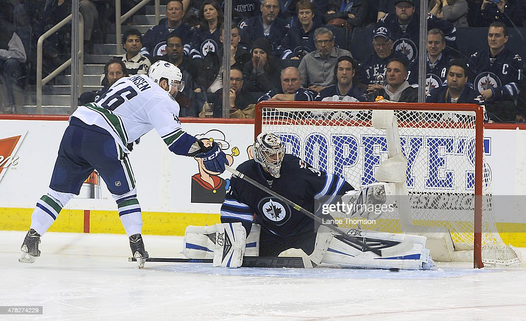 Goaltender Ondrej Pavelec #31 of the Winnipeg Jets does a split as he makes a pad save on <a gi-track='captionPersonalityLinkClicked' href=/galleries/search?phrase=Nicklas+Jensen&family=editorial&specificpeople=7444168 ng-click='$event.stopPropagation()'>Nicklas Jensen</a> #46 of the Vancouver Canucks during the shootout at the MTS Centre on March 12, 2014 in Winnipeg, Manitoba, Canada.