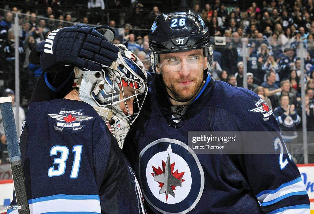 Goaltender Ondrej Pavelec #31 of the Winnipeg Jets gets congratulated by teammate <a gi-track='captionPersonalityLinkClicked' href=/galleries/search?phrase=Blake+Wheeler&family=editorial&specificpeople=716703 ng-click='$event.stopPropagation()'>Blake Wheeler</a> #26 after earning the 5-0 shutout over the Nashville Predators at the MTS Centre on November 8, 2013 in Winnipeg, Manitoba, Canada.