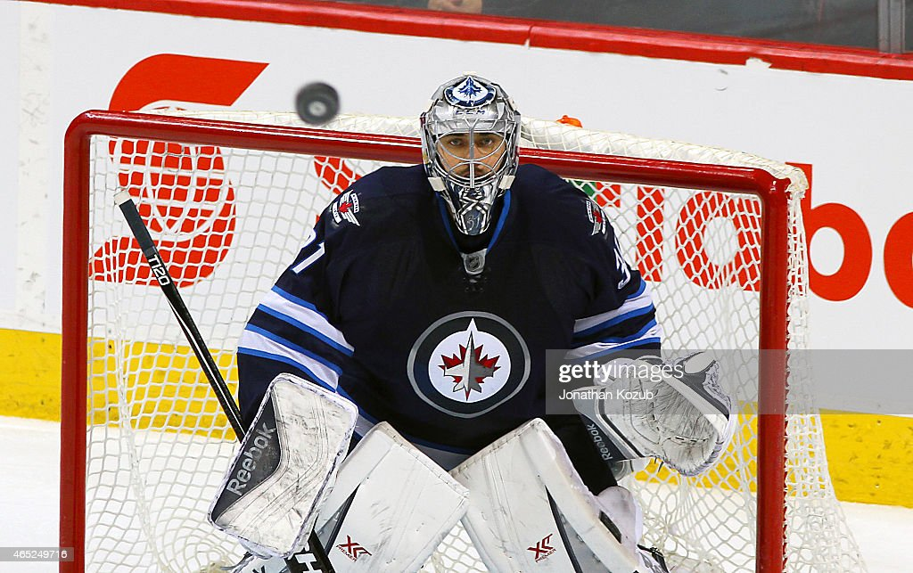 Goaltender Ondrej Pavelec #31 of the Winnipeg Jets keeps his eye on the puck during third period action against the Ottawa Senators on March 4, 2015 at the MTS Centre in Winnipeg, Manitoba, Canada. Pavelec replaced starting goaltender Michael Hutchinson in the second period of the game.