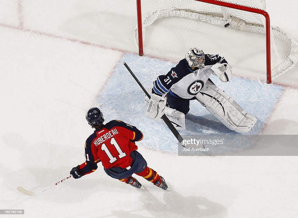 Goaltender Ondrej Pavelec #31 of the Winnipeg Jets looks badk into the net as the puck shot by <a gi-track='captionPersonalityLinkClicked' href=/galleries/search?phrase=Jonathan+Huberdeau&family=editorial&specificpeople=7144196 ng-click='$event.stopPropagation()'>Jonathan Huberdeau</a> #11 of the Florida Panthers scores on a penalty shot in the second period at the BB&T Center on March 5, 2013 in Sunrise, Florida. The Panthers defeated the Jets 4-1.