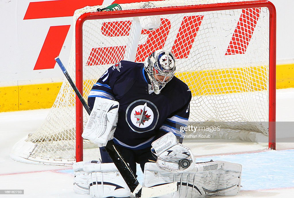 Goaltender Ondrej Pavelec #31 of the Winnipeg Jets makes a glove save against the Buffalo Sabres during first-period action at the MTS Centre on April 9, 2013 in Winnipeg, Manitoba, Canada.
