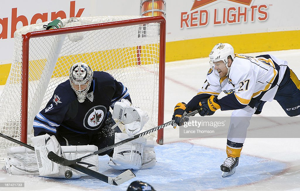 Goaltender Ondrej Pavelec #31 of the Winnipeg Jets makes a pad save as <a gi-track='captionPersonalityLinkClicked' href=/galleries/search?phrase=Patric+Hornqvist&family=editorial&specificpeople=1966879 ng-click='$event.stopPropagation()'>Patric Hornqvist</a> #27 of the Nashville Predators looks for the rebound during second period action at the MTS Centre on November 8, 2013 in Winnipeg, Manitoba, Canada.
