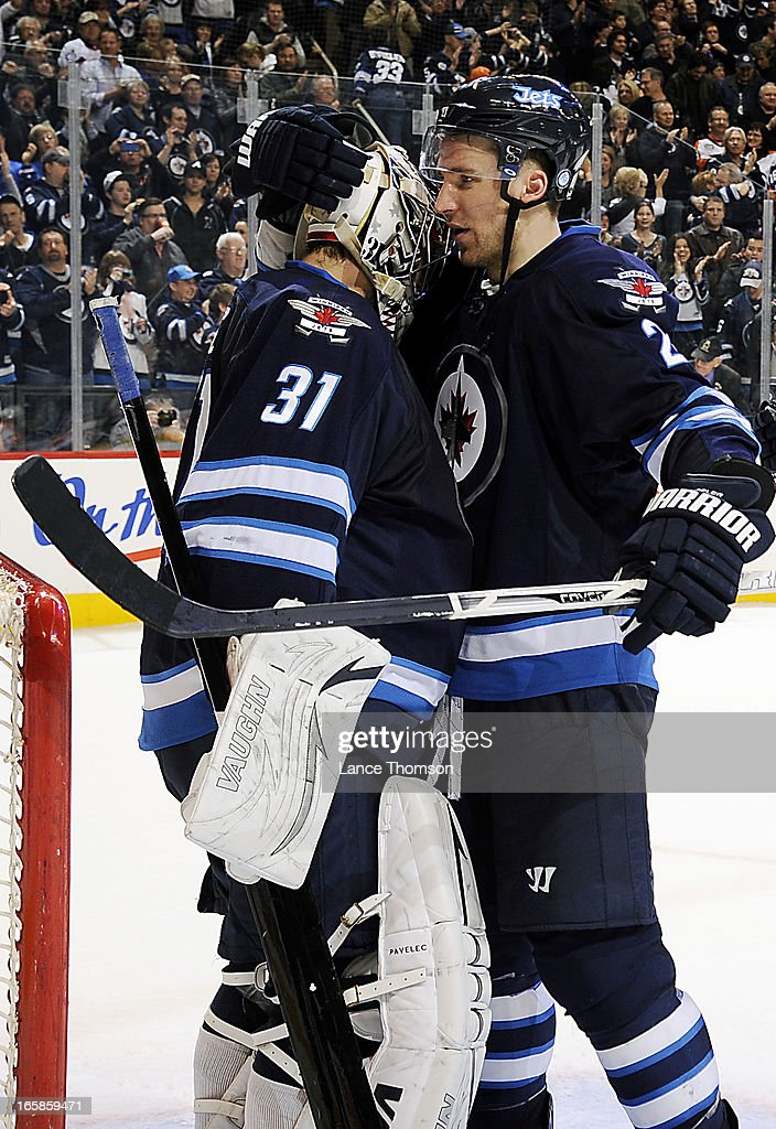 Goaltender Ondrej Pavelec #31 of the Winnipeg Jets receives a hug from teammate <a gi-track='captionPersonalityLinkClicked' href=/galleries/search?phrase=Blake+Wheeler&family=editorial&specificpeople=716703 ng-click='$event.stopPropagation()'>Blake Wheeler</a> #26 after backstopping the Jets to a 4-1 victory over the Philadelphia Flyers at the MTS Centre on April 6, 2013 in Winnipeg, Manitoba, Canada.