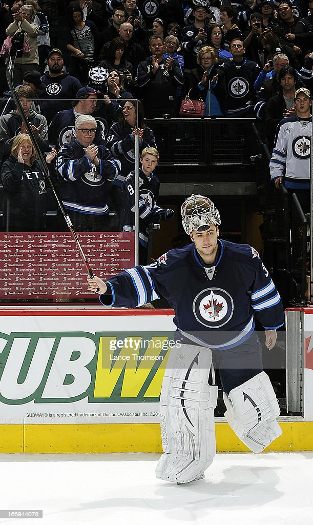 Goaltender <a gi-track='captionPersonalityLinkClicked' href=/galleries/search?phrase=Ondrej+Pavelec&family=editorial&specificpeople=3644118 ng-click='$event.stopPropagation()'>Ondrej Pavelec</a> #31 of the Winnipeg Jets salutes the home fans after receiving second star honors following a 4-3 overtime victory over the Carolina Hurricanes at the MTS Centre on April 18, 2013 in Winnipeg, Manitoba, Canada.