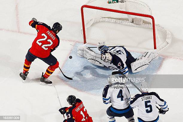 Goaltender Ondrej Pavelec of the Winnipeg Jets stops a shot by George Parros of the Florida Panthers during second period action at the BBT Center on...